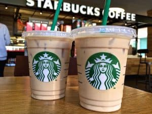 Two Starbucks Drinks with Cafe Counter Background