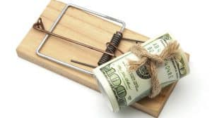 Bundle of Money Baiting a Mouse Trap